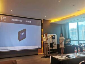 Chen Jiang from Pi and Fan Shuxing from Beijing Anyuan introducing Pi's products